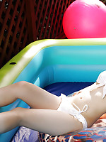 Naoko Sawano Asian with fit curves can´t wait to go to the sea